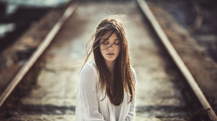 brunette, portrait, freckles, depth of field, face, railway, windy, long hair, emotion, girl outdoors, girl, closed eyes, white clothing