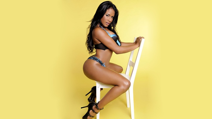 model, natural boobs, brunette, big boobs, chair, yellow background, Emmaly Lugo, high heels
