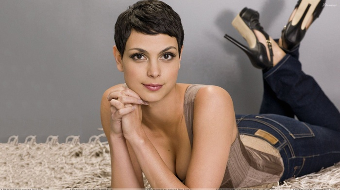 brown eyes, looking at viewer, short hair, lying on front, makeup, brunette, cleavage, high heels, Morena Baccarin, girl