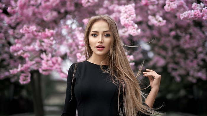 blue eyes, girl, long hair, trees, open mouth, face, blonde, girl outdoors, Alex Fetter, windy, brunette, black clothing, flowers, Maria Puchnina