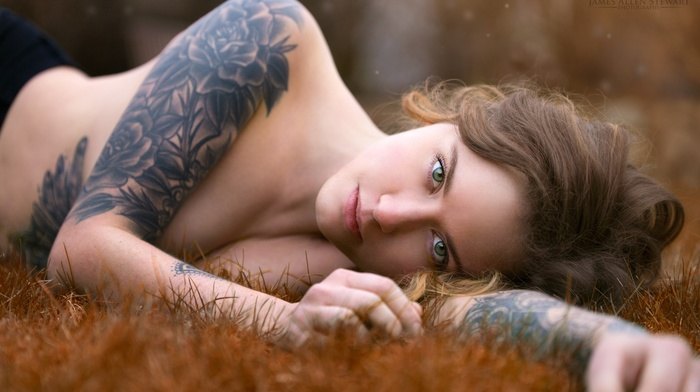 tattoo, sideboob, girl, girl outdoors, emotional, face, brunette, strategic covering, cleavage, green eyes, grass, topless, lying on side, James Allen Stewart