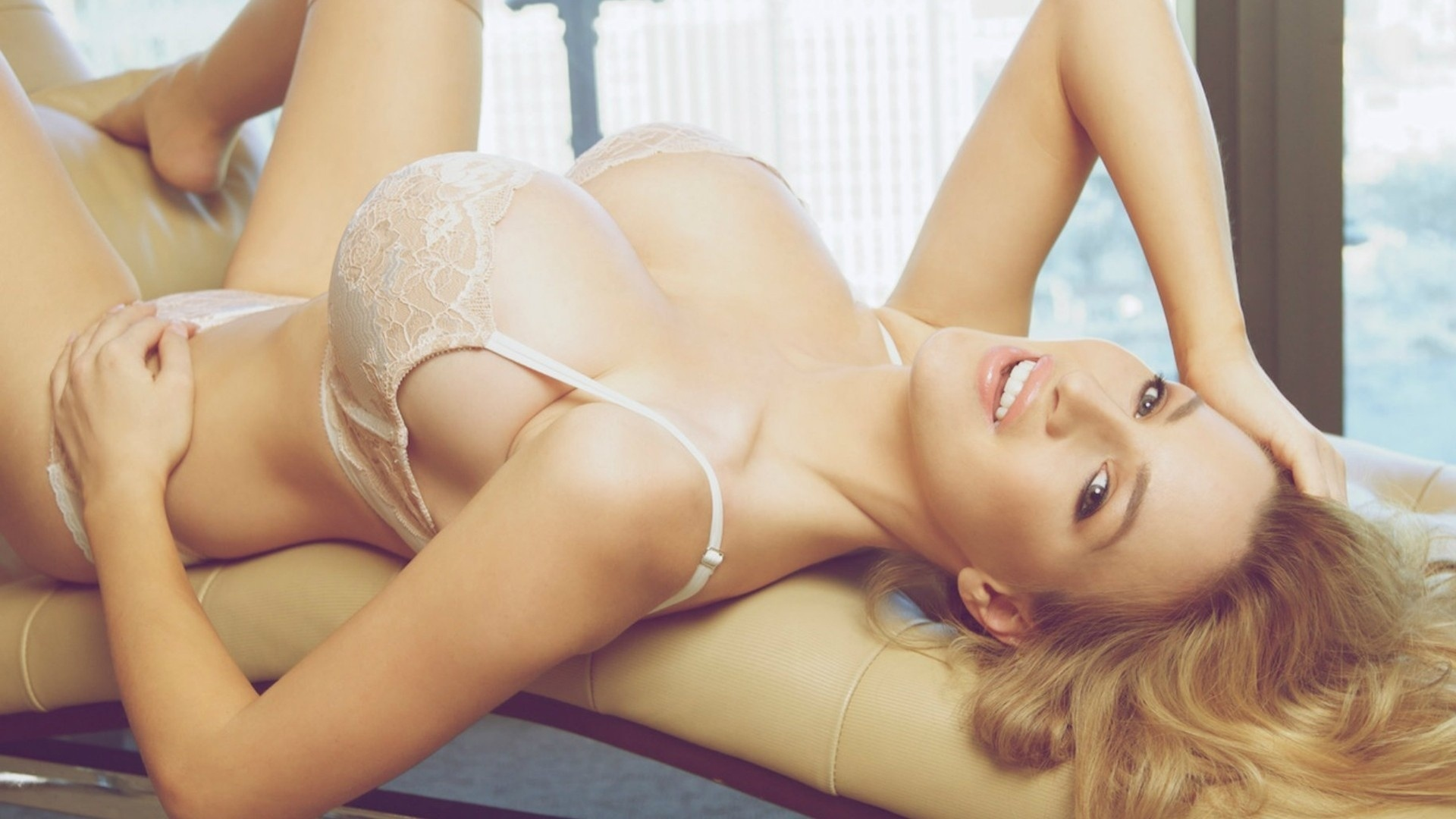 nude blonde laying down