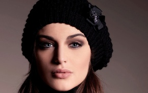 Lauren Budd, face, simple background, closeup, woolly hat, blue eyes
