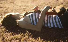 striped clothing, sunlight, musical instrument, lying down, girl