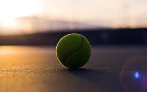 tennis balls, sunlight, blurred, lens flare, depth of field
