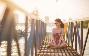 looking down, sunlight, smiling, water, long hair, bridge