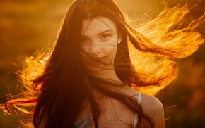 face, looking at viewer, windy, long hair, brunette, girl