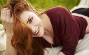 girl outdoors, lying down, looking at viewer, depth of field, freckles, smiling
