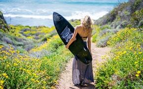 girl outdoors, surfing, blonde, skull and bones, model
