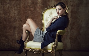 ponytail, jacket, legs  crossed, skirt, sitting, legs