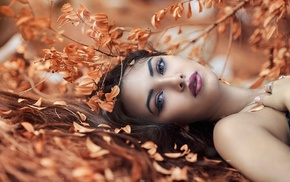 long hair, lying on back, girl outdoors, depth of field, makeup, girl