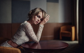 table, looking at viewer, model, blonde, hair bun, sitting