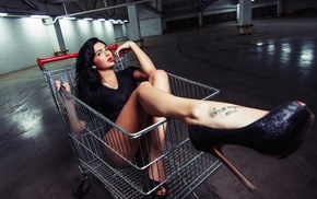 long hair, girl, tattoo, shopping cart, black clothing, finger in mouth