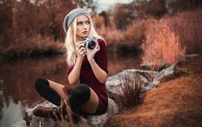 leggings, blonde, hat, camera, red dress, pond