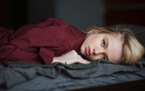 model, face, in bed, blonde, lying on front, depth of field