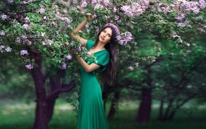 green dress, girl, flowers, wreaths, girl outdoors, trees