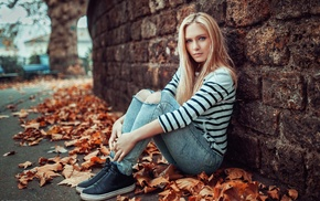 girl, jeans, blonde, wall, looking at viewer, sitting