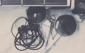 cigarettes, headphones, glasses, guitar, money