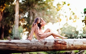 wood, sitting, barefoot, bokeh, hands on head, tree trunk