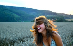 field, smiling, hair in face, girl