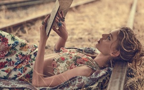 lying on back, railway, profile, map, girl outdoors, depth of field