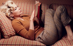 girl indoors, lying on back, blonde, actress, curly hair, sweater