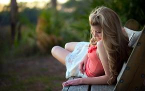 white skirt, bare shoulders, blonde, lying on side, depth of field, girl outdoors
