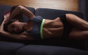 pierced navel, gym clothes, couch, tattoo, armpits, brunette